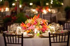 The tropical theme was emphasized with wicker chargers and exotic floral arrangements.