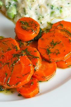 Maple Glazed Carrots with Dill.  This is a fab and easy way to make carrots that the whole family loves.  When I made the recipe I did not add the butter.   It saves on calories and no one noticed.  Also be sure that you dry your carrots well otherwise the glaze won't stick. I also just sprinkle the dill on just before serving.