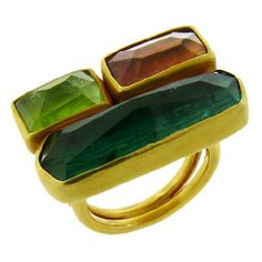 Tourmaline Peridot Ring Colorful, chunky and easy to wear tourmaline and peridot ring from Margoni, the rectangular sugarloaf-cut gems are s...