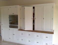 bifold doors cabinet doors | Large storage cabinets, with bi-folding doors and adjustable wine rack ...