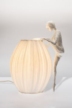 For nearly 10 years, Sophie Mouton-Perrat and Frédéric Guibrunet have combined soft lighting with delicate paper craft to create ethereal sculptures. Working under the name Papier à êtres, the duo uses the papier mâché technique to construct life-sized women clad in elegant, billowing gowns that double as lamps. The top portion of the unconventional, all-white lantern features the ladies' upper bodies while their pleated skirts illuminate the space.