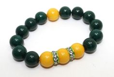 12mm dark green jade, golden yellow jade and green aluminum crystals encrusted stretch bangle bracelet