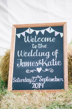Chalkboard notice sign with mini bunting - Image by Georgina Harrison - Rustic Marquee Wedding In Yorkshire With A Lavender And Dove Grey Colour Scheme With Bride In Cymbeline Of Paris Dress