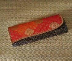 Banana fibre clutch with orange and red shibori Silk brocade clutch