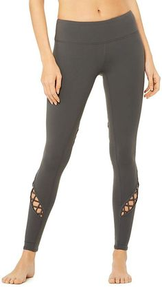 20baecd9c463a The Alo Yoga Entwine Legging features moisture wicking fabric with lace  detailing on the legs.