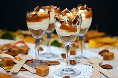 Served in wine goblets and sprinkled with pecans, these individual caramel cheesecake trifles are an impressive way to end a dinner party.