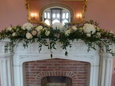 Flower display above the fireplace - can either be all white or shades of purple and white