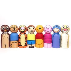 deep in the hundred-acre wood...  this listing is for eight (8) hand-painted winnie the pooh-inspired peg dolls.  each piece is hand-painted