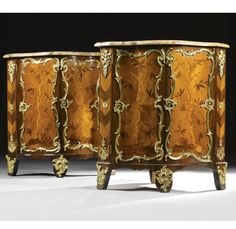 A pair of gilt-bronze-mounted bois satiné, amaranth, tulipwood, kingwood and marquetry encoignures both stamped J. Tuart JME and B. Péridiez Louis XV, mid 18th century