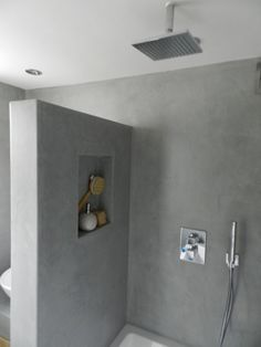 amazing concrete walls bring in a modern look to this #bathroom #remodel www.remodelworks.com