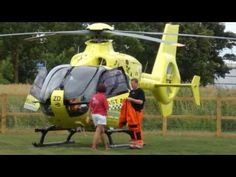East Anglian Air Ambulance Arrives at Milton Maize Family Fun Day - YouTube
