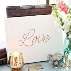 Using twine, a paper punch, and embroidery needle and a canvas - you can create easy and customized art.