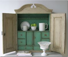 Tone on Tone.  19th century wall cupboard with green paint