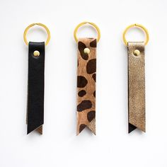 Gold Leather Keyring, Metallic Leather Key Fob, Black Leather Keychain, Leopard Key fob, Gold Keyring, Black Leather Keychain by gmaloudesigns on Etsy https://www.etsy.com/listing/253522550/gold-leather-keyring-metallic-leather