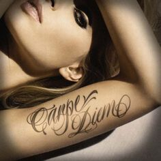 Like the light scriptive and CARP DIEM tattoo here.. maybe smaller. On side of ribs under bra strap.