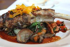 Veal Chop Tchouplitoulas with herb roasted oyster mushrooms, sweet potatoes, baby swiss chard and honey peppercorn glaze