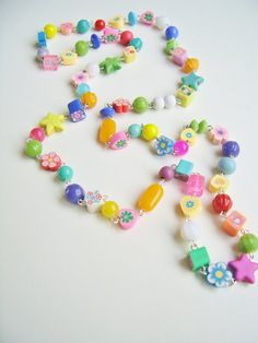 A bright coloured beaded necklace by Silly Old Suitcase on Etsy