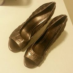 Vince Camuto heels Size 10 beautiful bronzish color. Open toe. Gently worn a few times. The left one has a tiny spot thats white but its on the side facing in so not visible. Vince Camuto Shoes Heels