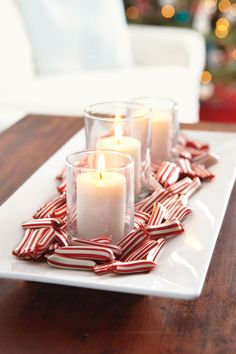 This modern candy dish doubles as a red-and-white centerpiece. Just pile peppermint puffs around a trio of simple votives.