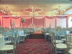 The Elegant Event Lighting team designed the fabric and crystal curtain backdrop which welcomed the couple's guests into the West Ballroom.  Adrianna and Elias chose soft pink uplighting for the backdrop which made all of the crystals glisten!