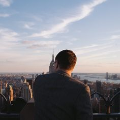 The Backs Of Strangers Overlooking New York City