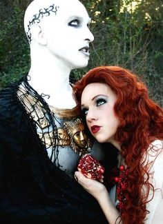 Persephone and Hades. Nice take on Hades, though I never pictured Persephone as a redhead. The deep red of that pomegranate is pretty intense.