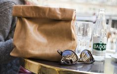 Is it a purse or your old lunch brown paper bag? Thanks to French leather accessories designer Marie Turnor, one may never no. Fall Accessories, Leather Accessories, Jil Sander, Leather Clutch, Leather Purses, Picnic Bag, Brown Bags, Purses And Bags, Sunglasses Case