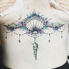 http://www.revelist.com/arts/underboob-tattoos/5179/Unleash your inner Ariel and get this mermaid-inspired tattoo./12/#/12