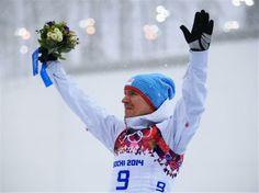 Gold medalist Emil Hegle Svendsen of Norway celebrates on the podium during the flower ceremony for the Men's 15 km Mass Start