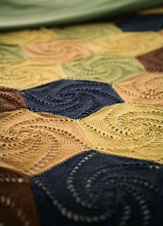 colorful crocheted coverlet is pieced together from swirled hexagons worked in coordinating shades. Tutorial ༺✿Teresa Restegui http://www.pinterest.com/teretegui/✿༻