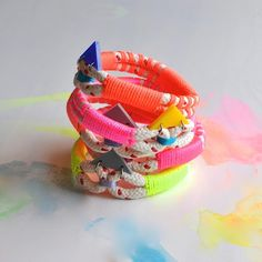 Our original Woven Bracelets are handmade from cotton rope, neon cord  and custom made perspex triangles.