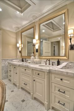 "The paint color is an off- white custom lacquer blend, very similar to ""Benjamin Moore Swiss Coffee"".  The cabinet panels are recessed shaker panels with a bead detail.  Cabinet hardware is from Restoration Hardware. Bathroom Vanity Ideas. Beautiful Double bathroom vanity with marble countertop. #Bathroom #BathroomVanity #bathroomVanityDesign"