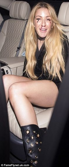 Good spirits: Ellie flashed a smile as she left the bash in the early hours of the morning
