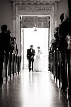 Black and white shot of bride entering the church