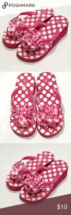 🆕Pink Polkadot Wedge Flip Flops, Small New Girl's Flip Flops Pink Dot pattern sole with coordinating silky floral piece at toe strap. Thong type slip on. (Plastic between toes). Lightweight construction. No tags but manufacturing plastic in tact. Wedge approx 1.5 inches high Size Small (Little girl 11 to 12) Unsure Shoes Sandals & Flip Flops