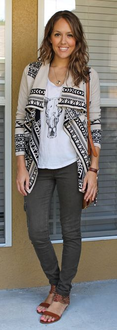 Not sure how I feel about the aztec sweater, but like the look here. Graphic tee & olive/grey pants.