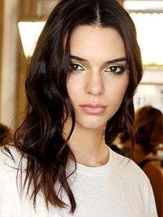 Another day, another beauty idea that comes courtesy of Kendall Jenner. The latest look we want to steal from her? The green eye shadow she (and the other models) wore on the runway at the Versace haute couture show...