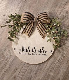This one of a kind round wreath is adorable!! Perfect for anytime of the year! While it is not recommended to be put outside you could. I just do not know how it would hold up against Mother Nature. This wreath features a vinyl design placed on a canvas material, adorned with a faux burlap bow.