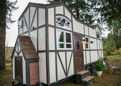 This is a beautiful Tudor-style tiny house on wheels by Tiny Heirloom. It was featured on a recent episode of their television series, Tiny Luxury which is on the HGTV/DIY Network. Tiny House Exterior, Wall Exterior, Casas Tudor, Estilo Tudor, Casa Loft, Tiny House Living, Small Living, Living Spaces, Tudor House