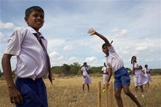 Sri Lanka, 2009: Boys play cricket outside the Vadamunai Government Tamil Mixed School in Batticaloa District, Eastern Province. The district continues to recover from both the 2004 tsunami and the decades-long civil conflict that finally ended in May 2009. The school was closed due to conflict in 2007, but reopened in January 2009 with support from UNICEF. ©UNICEF/Pietrasik
