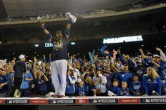 Oct 15, 2014; Kansas City, MO, USA; Kansas City Royals catcher Salvador Perez celebrates with fans on top of the dugout after game four of the 2014 ALCS playoff baseball game against the Baltimore Orioles at Kauffman Stadium. The Royals swept the Orioles to advance to the World Series. (Denny Medley-USA TODAY Sports)