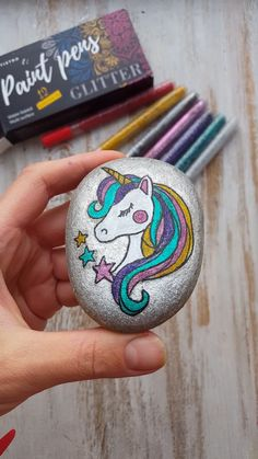 DIY Unicorn - Gorgeous painted rock with Artistro paint pens. - DIY Unicorn – Gorgeous painted rock with Artistro paint pens. DIY painted rock with unicorn. Glitter Paint Markers, Paint Marker Pen, Diy Unicorn, Unicorn And Glitter, Unicorn Crafts, Unicorn Foods, Rock Painting Designs, Paint Designs, Rock Painting Kids