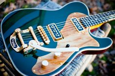Whoa Baby! Chambered Mahogany with a T'armonds and Bigsby and a stunning Cadillac Green nitro top? Stunning looks and luscious sound, what more do you want? SOLD CLICK THE IMAGE TO OPEN THE EXTENDE...