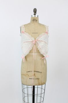 Gorgeous Edwardian cotton camisole! Made in a bright white cotton that is fully adorned with soft girly pink ribbon. Lace detailing around neckline
