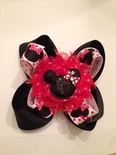 Boutique Minnie Mouse Stacked Bow Red polka dots sequin minnie mouse. $12.00, via Etsy.