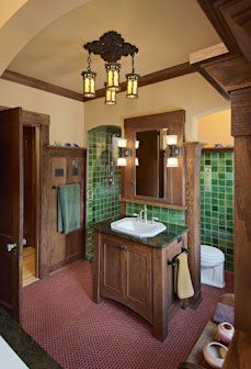 Luxurious Arts and Crafts bathroom with green tile