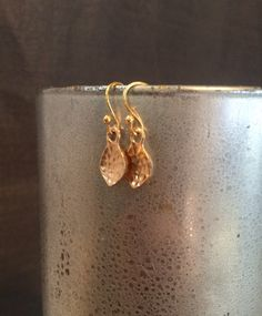 A personal favorite from my Etsy shop https://www.etsy.com/listing/226527079/gold-plated-hammered-drop-minimalist-14k
