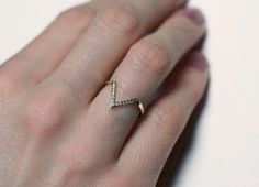 this ring in white gold would be the perfect band to fit around my oddly-shaped engagement ring