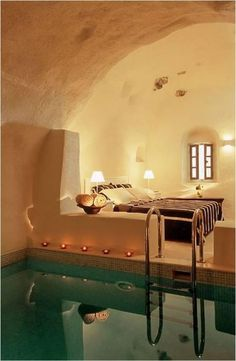 Bedroom Spa, Santorini, Greece. If we have this room in Greece dont expect us to come home! 3 more weeks baby!