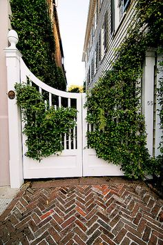 Charleston gate--love the herringbone brick path! Modern Garden Design, Landscape Design, Beautiful Gardens, Beautiful Homes, Outdoor Spaces, Outdoor Living, Garden Gates, Garden Entrance, Architecture